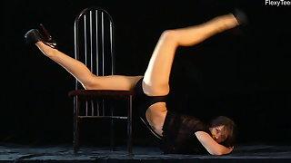 Naked gymnast Kim Nadara doing gymnastics greater than chair