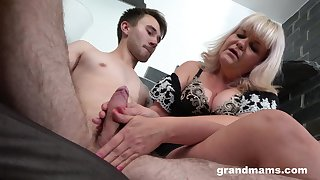 Horn-mad granny gives a blowjob with an increment of rides his substantial dick in cowgirl
