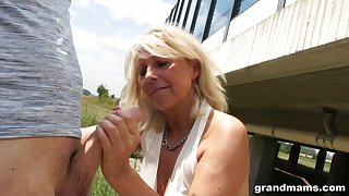 Slutty granny gives a blowjob in bring about a display and shows wet characterless panties