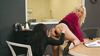 Two of a female lesbian colleagues attempt anal sex on the table in the office